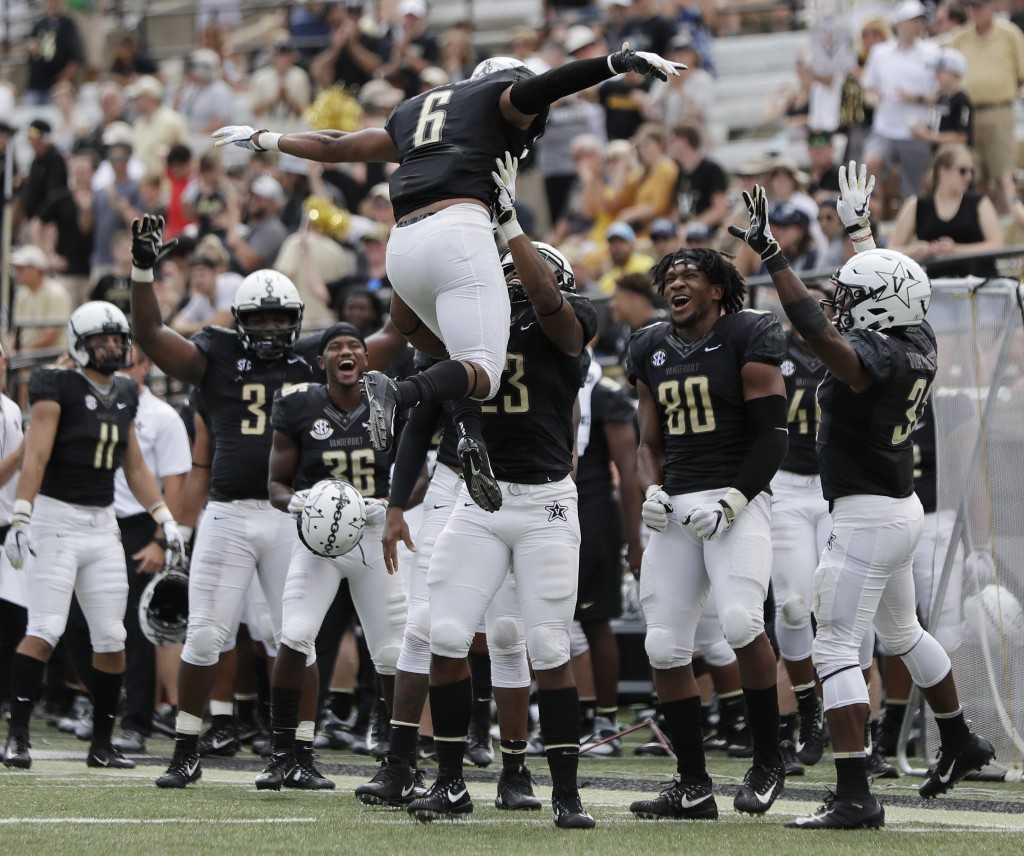 Vanderbilt running back Josh Crawford (6) celebrates after scoring a touchdown on a 1-yard run against Nevada in the second half of an NCAA college fo...