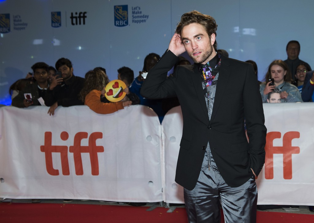 "Actor Robert Pattinson poses for photographs on the red carpet after arriving for the new movie ""High Life"" during the 2018 Toronto International Film"