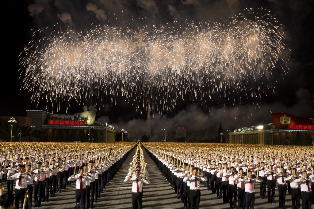 In this Monday, Sept. 10, 2018, file photo, North Korean students take part in a torch light march held in conjunction with the 70th anniversary of No