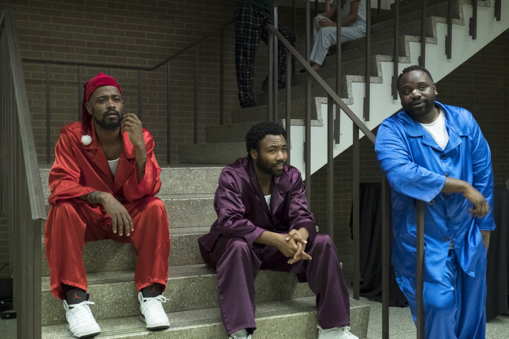 """This image released by FX shows, from left, Lakeith Stanfield, Donald Glover and Brian Tyree Henry in a scene from the comedy series """"Atlanta."""" The pr"""