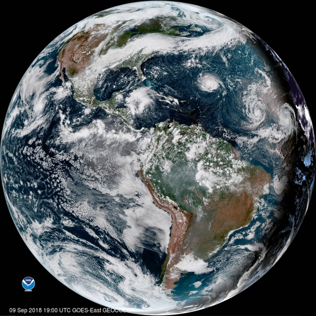 This enhanced satellite image provided by NOAA shows Hurricane Florence, third from right, in the Atlantic Ocean on Sunday, Sept. 9, 2018. At right is