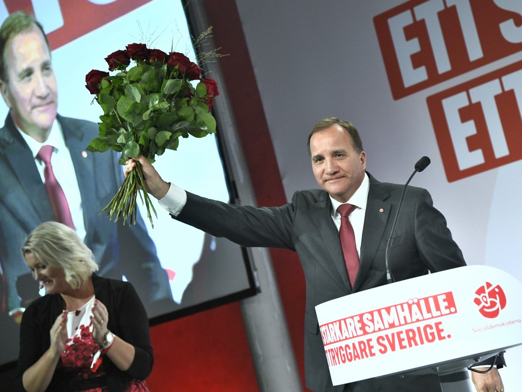 Prime minister and party leader of the Social Democrat party Stefan Löfven waves at an election party in Stockholm, Sweden, Sunday, Sept. 9, 2018. Pre