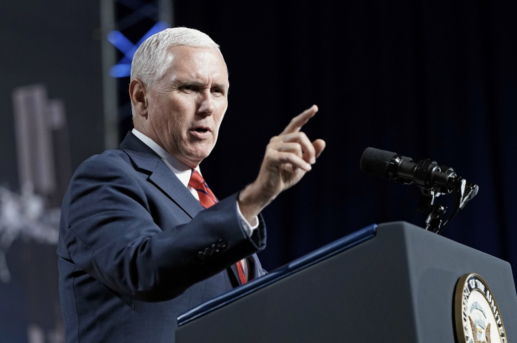 """FILE - In this Aug. 23, 2018, file photo, Vice President Mike Pence speaks during a visit to NASA's Johnson Space Center in Houston. Pence says he's """"..."""