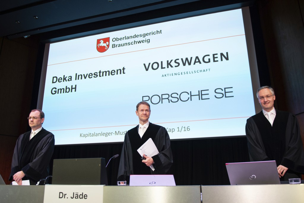 Judges Nicolai Stephan,  Christian Jaede and Friedrich Hoffmann, from left, arrive for the opening of a lawsuit against Volkswagen on compensation for