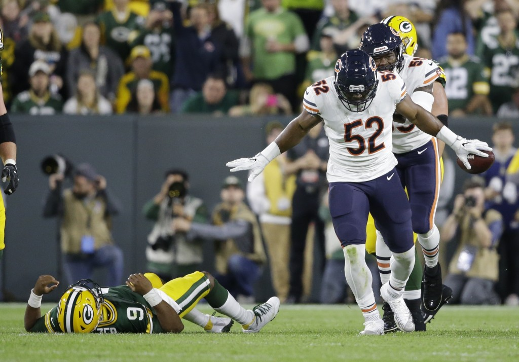 Chicago Bears' Khalil Mack reacts after recovering a fumble during the first half of an NFL football game against the Green Bay Packers Sunday, Sept.