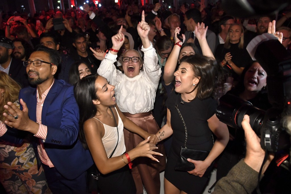 Supporters attend the Social Democratic Party's election night party in Stockholm, Sweden, Sunday, Sept. 9, 2018. A preliminary count from Sweden's ge
