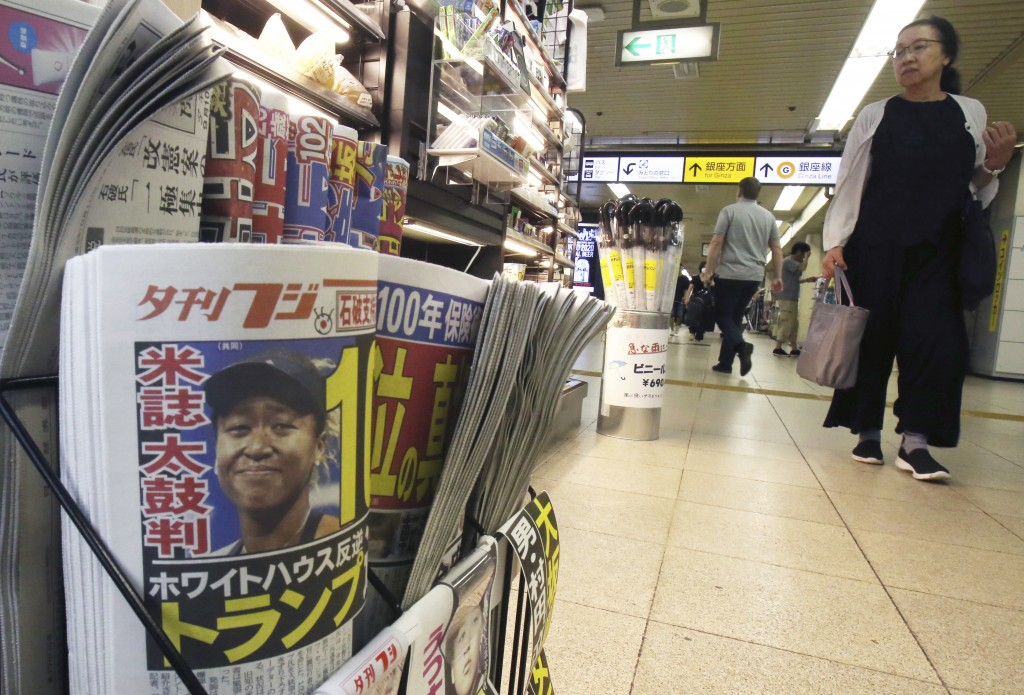 Sports and tabloid newspapers reporting Naomi Osaka's victory in the U.S. Open tennis finals are sold at a newsstand in Tokyo, Monday, Sept. 10, 2018.