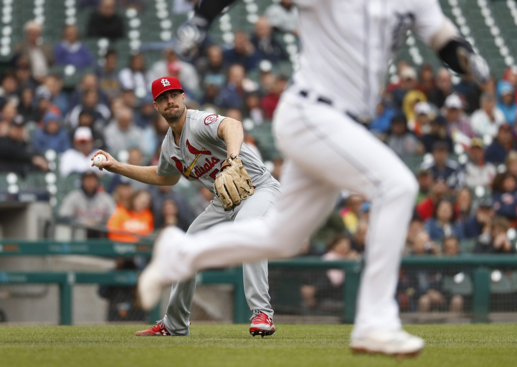 St. Louis Cardinals pitcher John Gant throws to first base for an out on a Detroit Tigers' Ronny Rodriguez bunt in the fifth inning of a baseball game