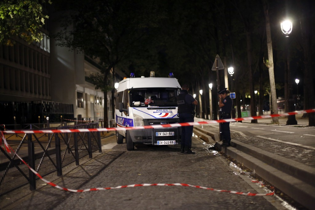 Police officers secure the site of a knife attack in Paris, Monday, Sept. 10, 2018. A several people were injured in a knife attack in central Paris l