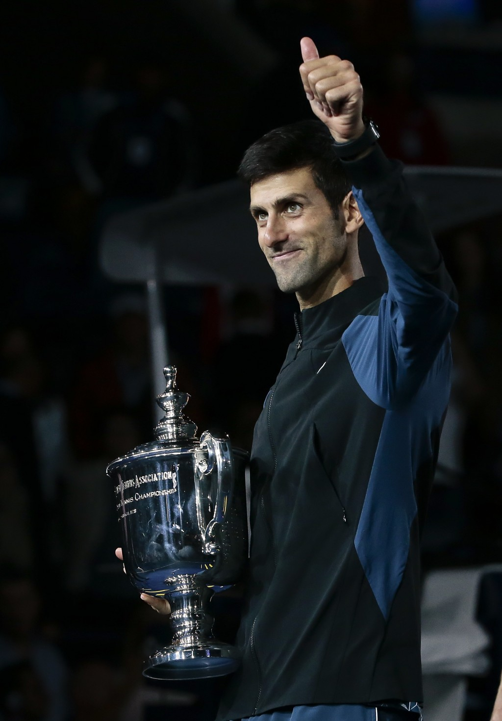 Novak Djokovic, of Serbia, holds the trophy after defeating Juan Martin del Potro, of Argentina, in the men's final of the U.S. Open tennis tournament