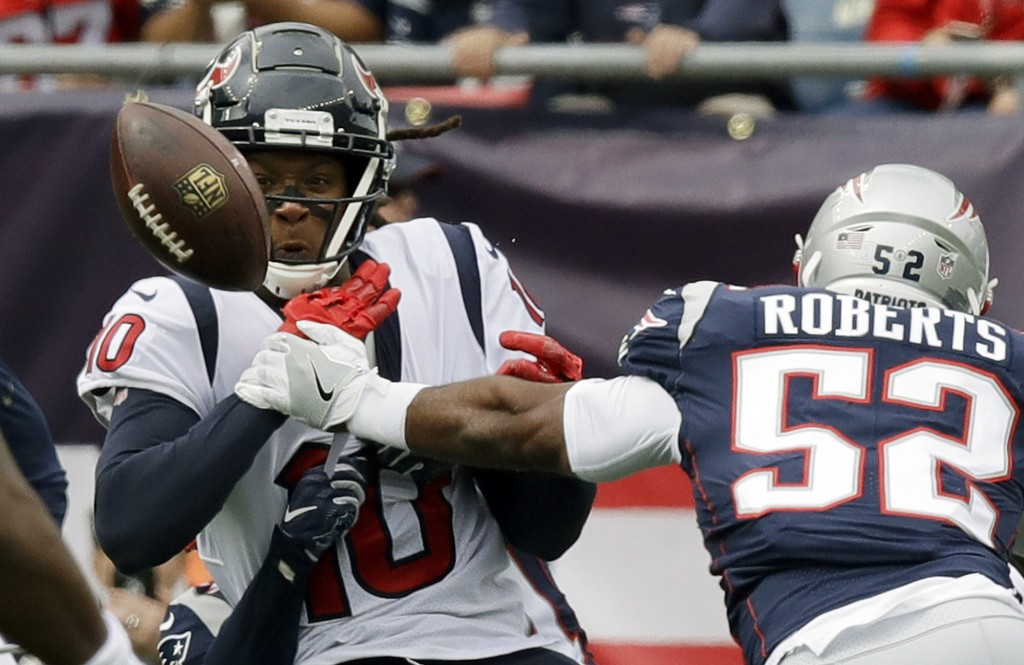 New England Patriots linebacker Elandon Roberts (52) breaks up a pass intended for Houston Texans wide receiver DeAndre Hopkins (10) during the first