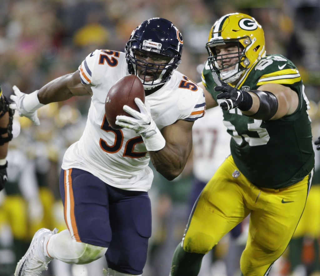 Chicago Bears' Khalil Mack intercepts a pass and returns it for a touchdown during the first half of an NFL football game against the Green Bay Packer