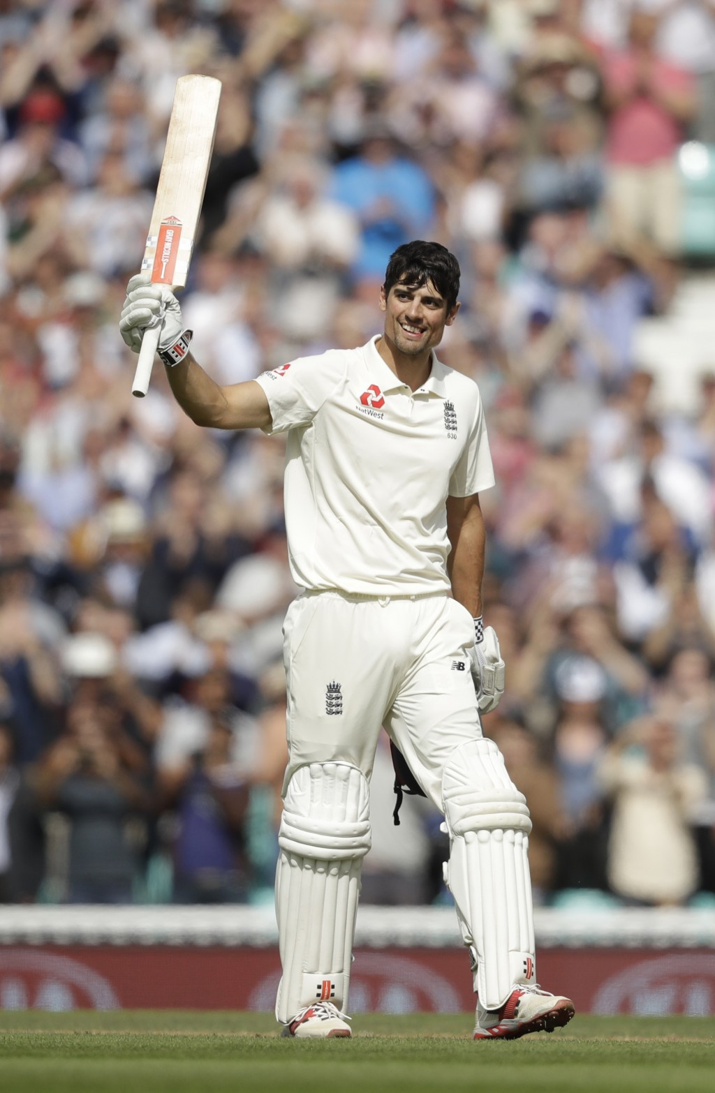 England's Alastair Cook, in his last ever batting innings before retiring from test cricket, celebrates reaching his century during the fifth cricket