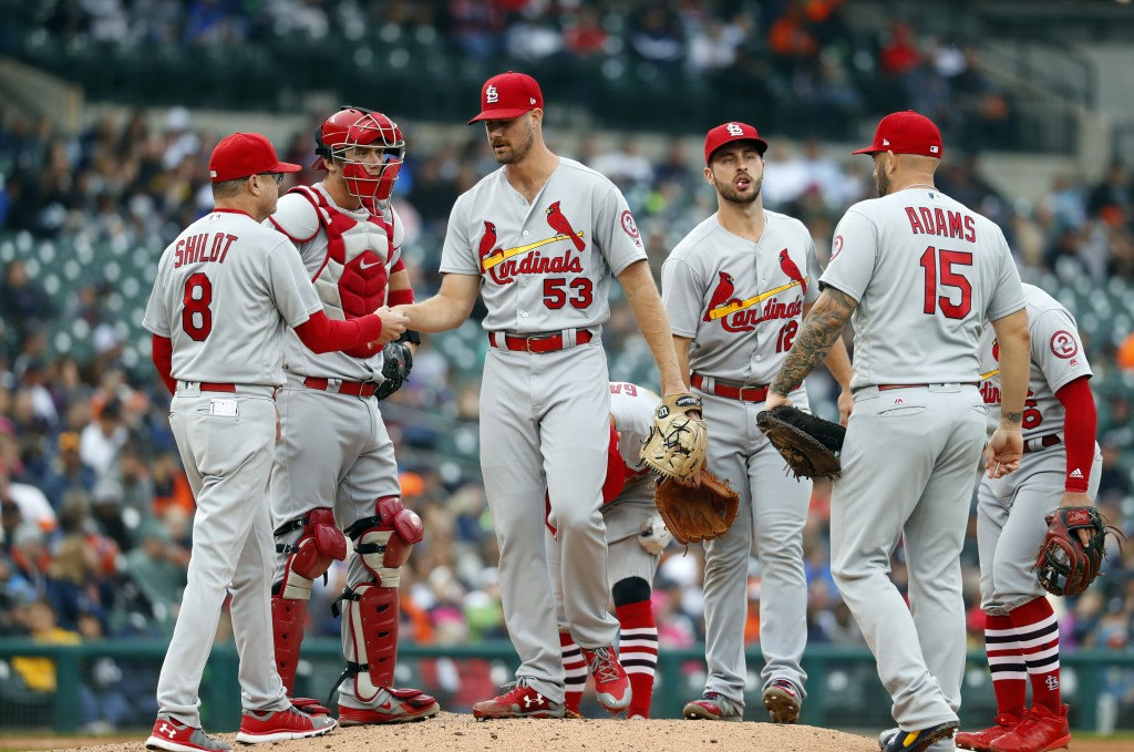 St. Louis Cardinals manager Mike Shildt (8) takes the ball from pitcher John Gant (53) in the seventh inning of a baseball game against the Detroit Ti