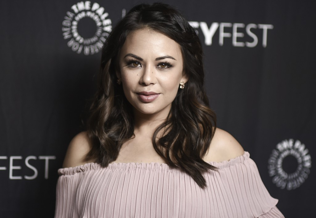 "FILE - In this March 25, 2017, file photo, Janel Parrish attends the 34th annual PaleyFest: ""Pretty Little Liars"" event at the Dolby Theatre in Los An"