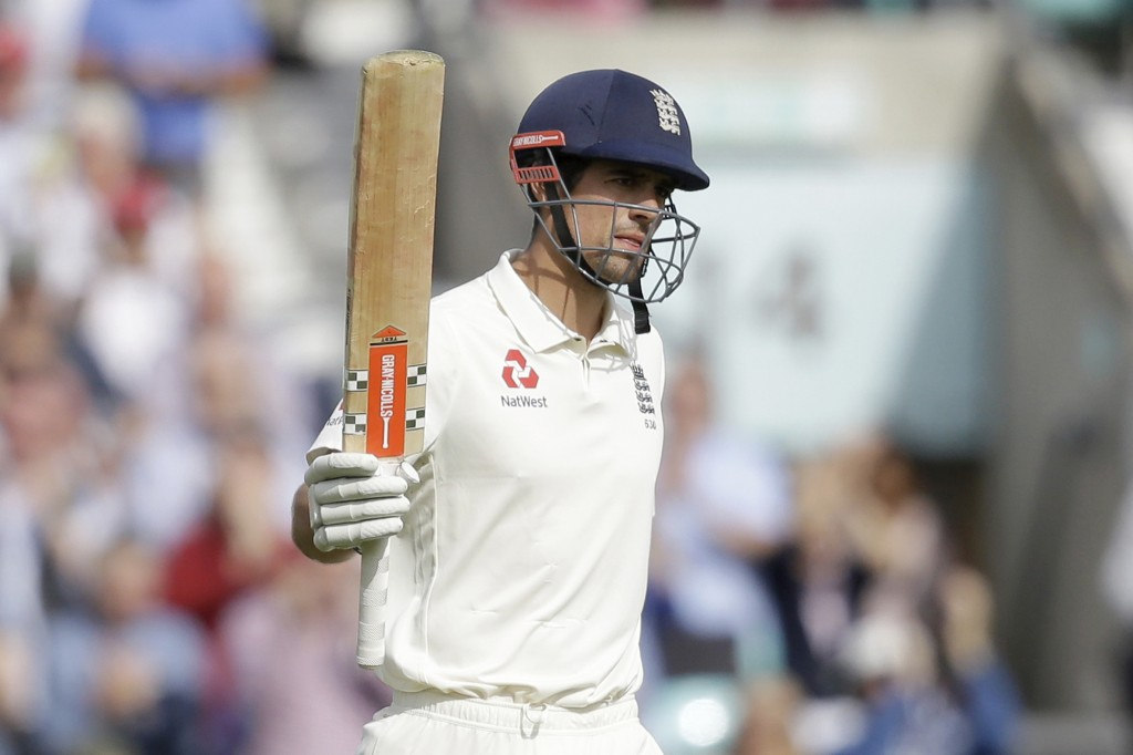 England's Alastair Cook, in his last ever batting innings before retiring from test cricket, celebrates reaching 50 runs during the fifth cricket test