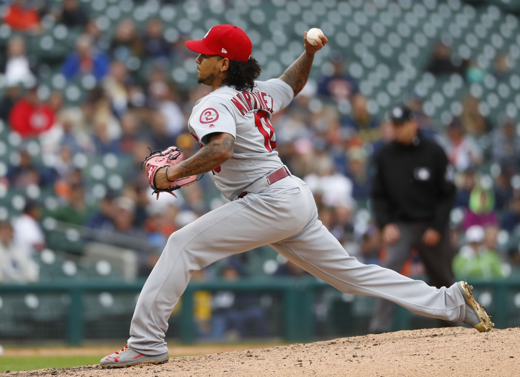St. Louis Cardinals pitcher Carlos Martinez throws against the Detroit Tigers in the ninth inning of a baseball game in Detroit, Sunday, Sept. 9, 2018