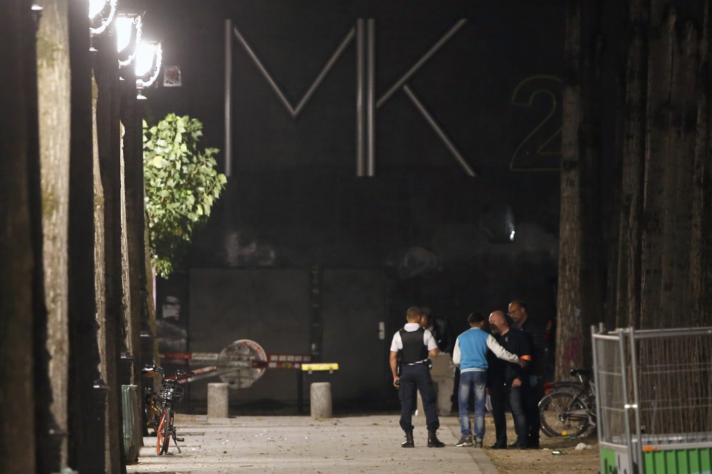 Police officers work on the scene of a knife attack in Paris, Monday, Sept. 10, 2018. A several people were injured in a knife attack in central Paris