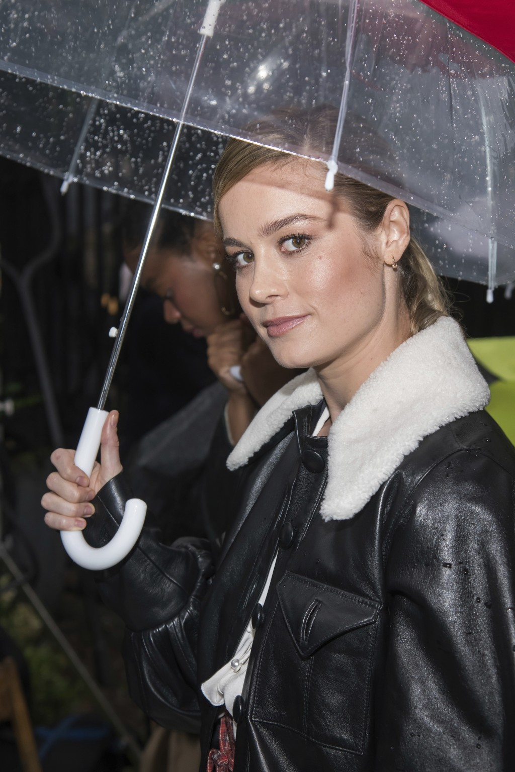 Brie Larson attends the Rodarte show, which was held outside in the rain, during Fashion Week on Sunday, Sept. 9, 2018 in New York. (Photo by Charles