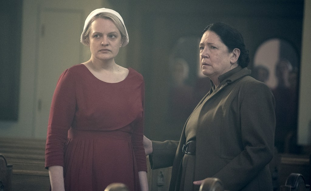 """This image released by Hulu shows Elisabeth Moss, left, and Ann Dowd in a scene from """"The Handmaid's Tale."""" The program was nominated for an Emmy on T"""