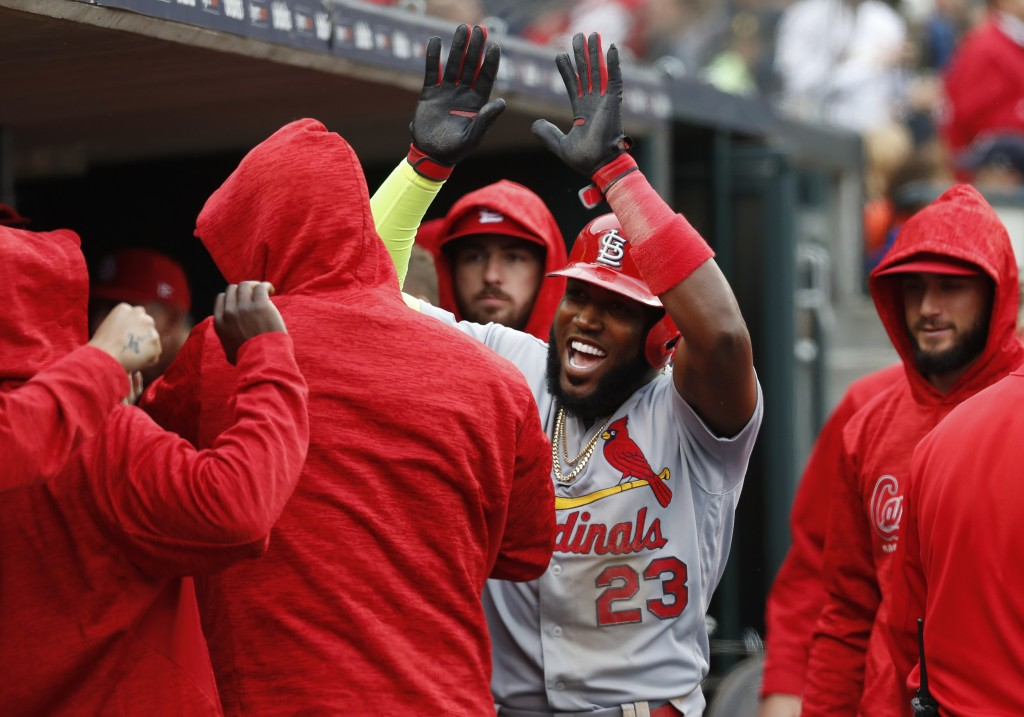 St. Louis Cardinals' Marcell Ozuna (23) reacts after scoring in the seventh inning of a baseball game against the Detroit Tigers in Detroit, Sunday, S
