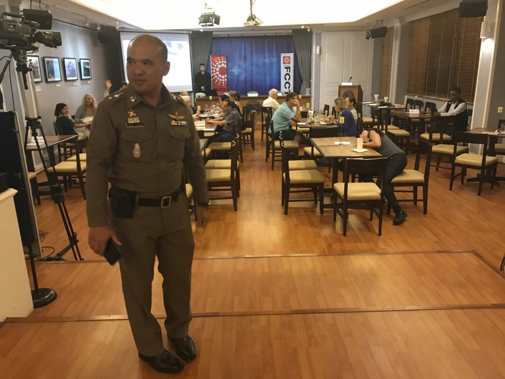 "In this Thursday, Sept. 6, 2018, photo, a Thai policeman stands inside Foreign Correspondents' Club of Thailand during an event titled: ""Will Myanmar'"