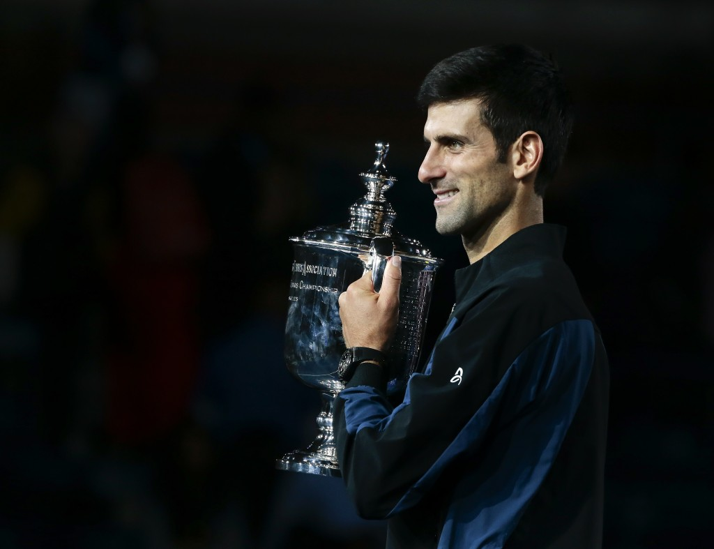 Novak Djokovic, of Serbia, holds the championship trophy after defeating Juan Martin del Potro, of Argentina, in the men's final of the U.S. Open tenn
