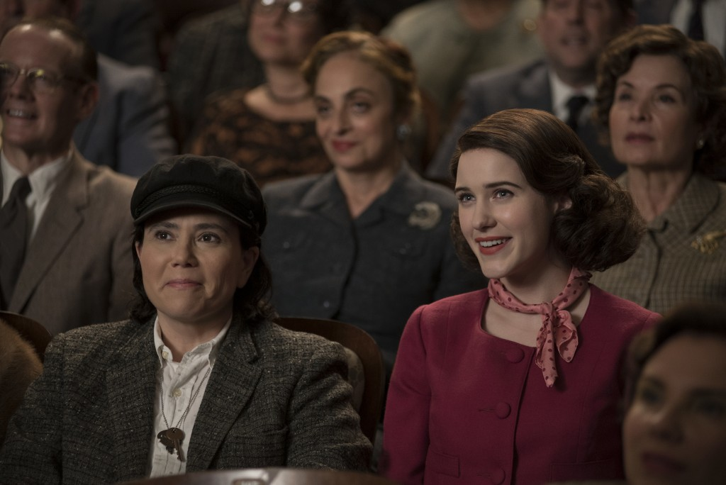 """This image released by Amazon shows Alex Borstein, left, and Rachel Brosnahan in """"The Marvelous Mrs. Maisel."""" The program was nominated for an Emmy on"""