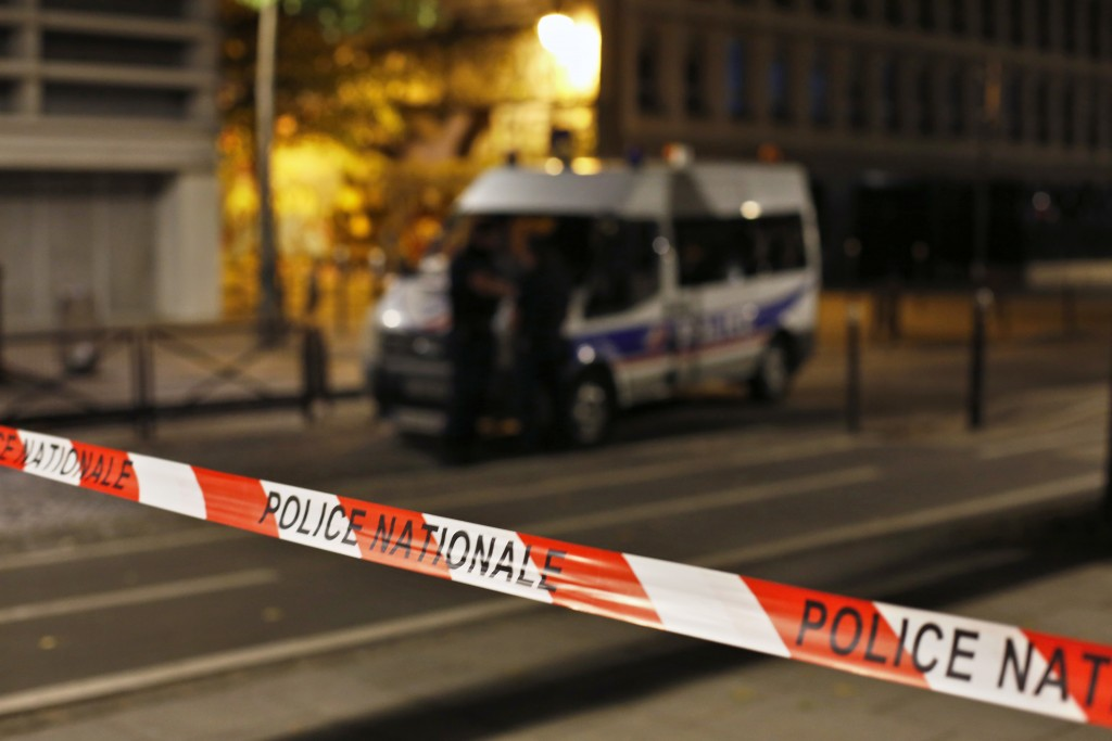 Police secures the site of a knife attack in Paris, Monday, Sept. 10, 2018. A several people were injured in a knife attack in central Paris late Sund