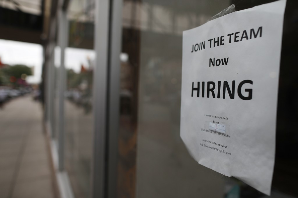 "In this July 18, 2018, photo a ""now hiring"" sign hangs in the window of a Chinese restaurant in downtown Fargo, N.D. On Tuesday, Sept. The Labor Depar"