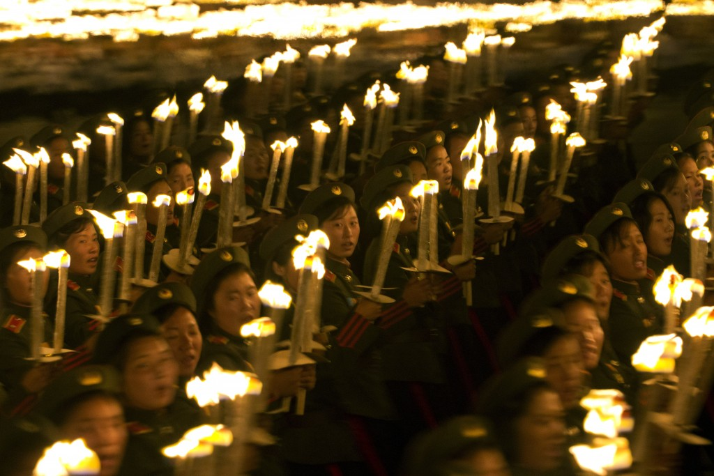 North Korean military cadets take part in a torch light march held in conjunction with the 70th anniversary of North Korea's founding day celebrations