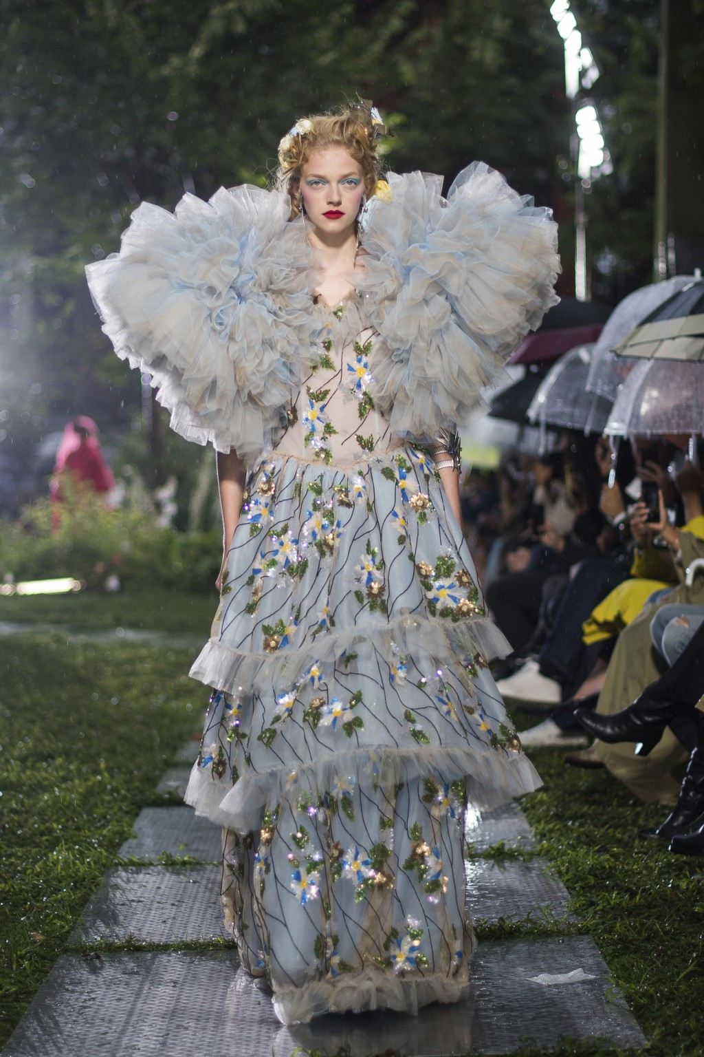 A model walks in the Rodarte show, which was held outside in the rain, during Fashion Week on Sunday, Sept. 9, 2018 in New York. (Photo by Charles Syk