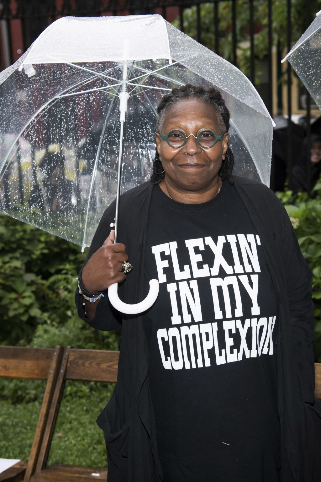 Whoopi Goldberg attends the Rodarte show, which was held outside in the rain, during Fashion Week on Sunday, Sept. 9, 2018 in New York. (Photo by Char