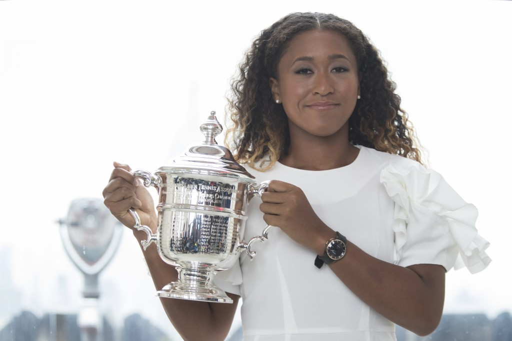 US Open women's singles champion Naomi Osaka poses for photographers with her trophy at Top of the Rock Observation Deck at Rockefeller Center, Sunday