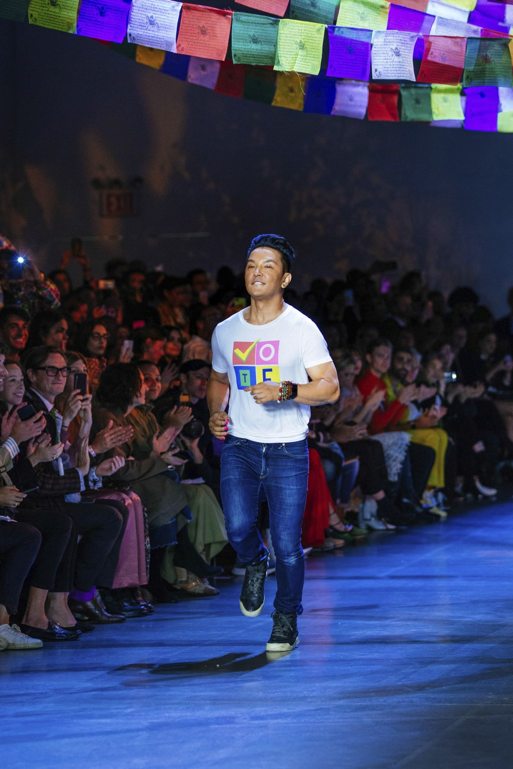 Prabal Gurung jogs onto the runway following his spring 2019 collection during Fashion Week Sunday, Sept. 9, 2018, in New York. (AP Photo/Kevin Hagen)