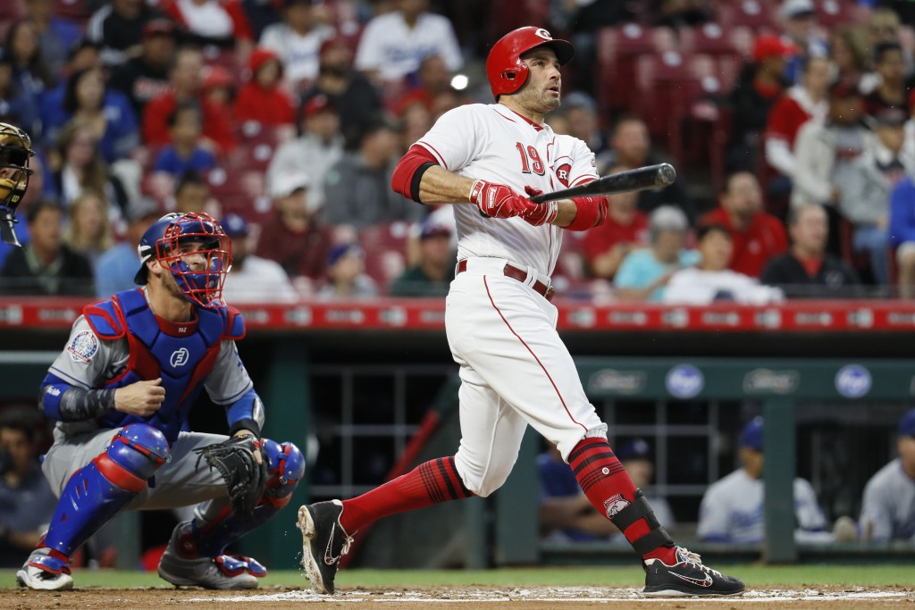 Cincinnati Reds' Joey Votto hits a two-run double off Los Angeles Dodgers starting pitcher Alex Wood in the first inning of a baseball game, Monday, S