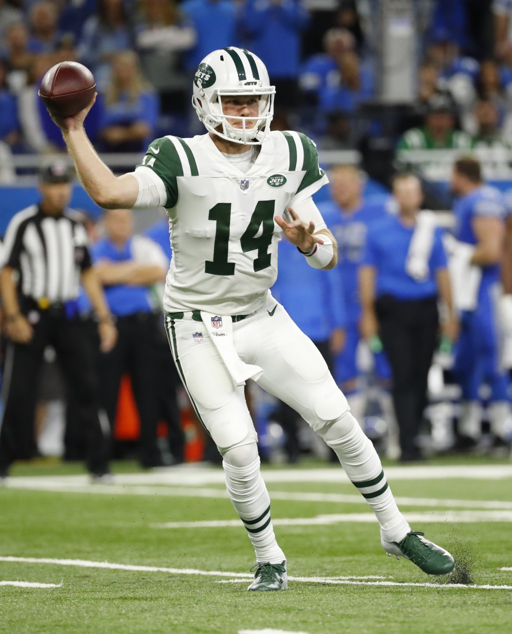 New York Jets quarterback Sam Darnold (14) throws against the Detroit Lions in the first half of an NFL football game in Detroit, Monday, Sept. 10, 20