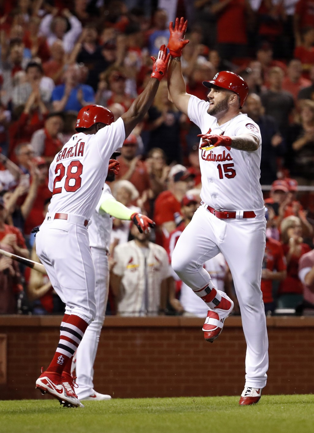 St. Louis Cardinals' Matt Adams (15) is congratulated by teammate Adolis Garcia (28) after hitting a three-run home run during the eighth inning of a