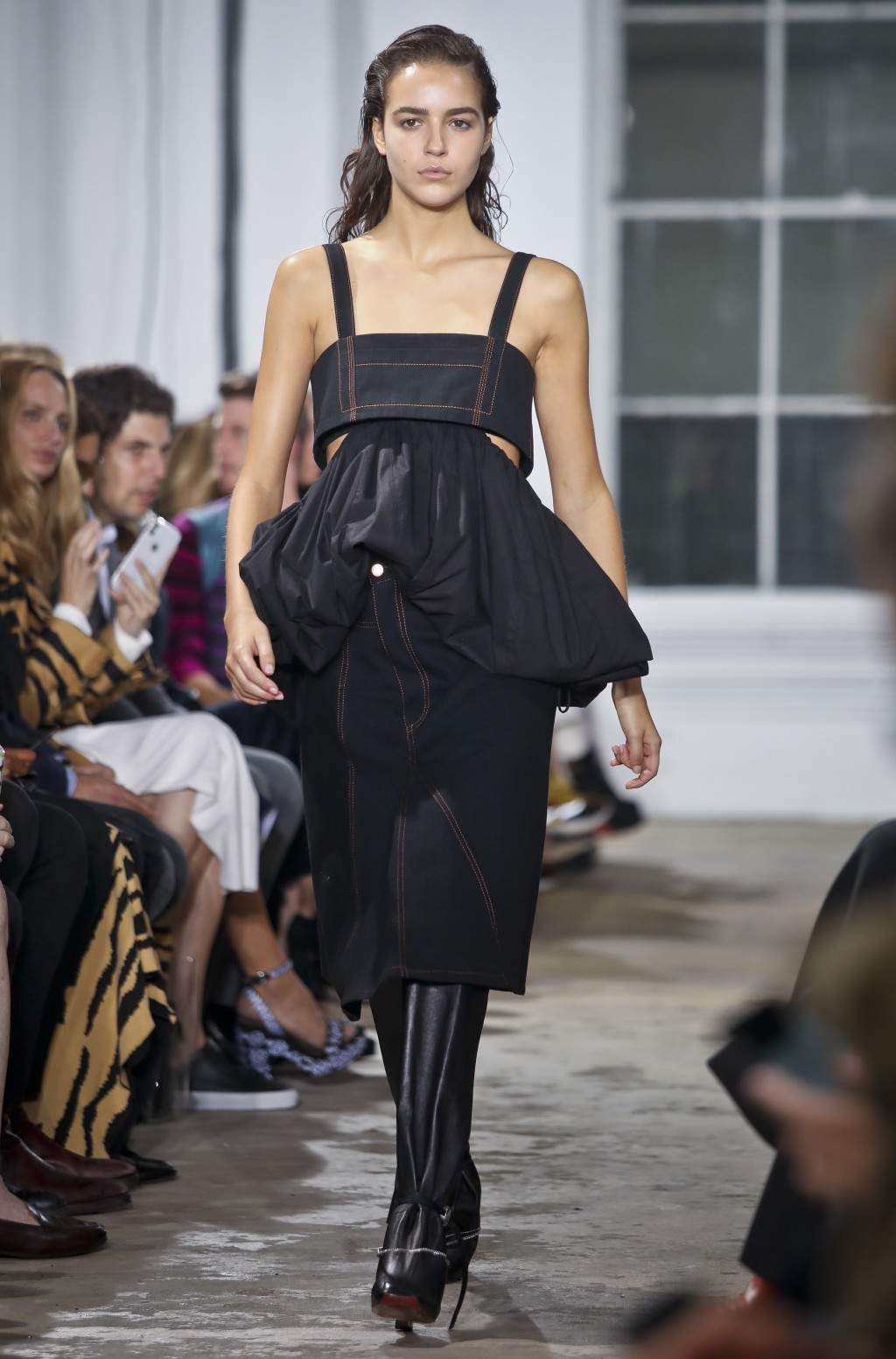 Fashion from Proenza Schouler collection is modeled during Fashion Week, Monday, Sept. 10, 2018 in New York. (AP Photo/Bebeto Matthews)
