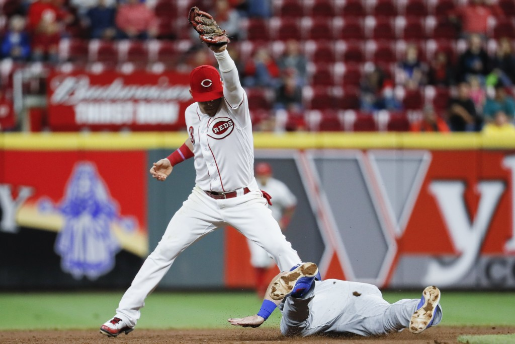 Cincinnati Reds second baseman Scooter Gennett (3) completes a double play by forcing out Los Angeles Dodgers' Max Muncy, right, in the seventh inning