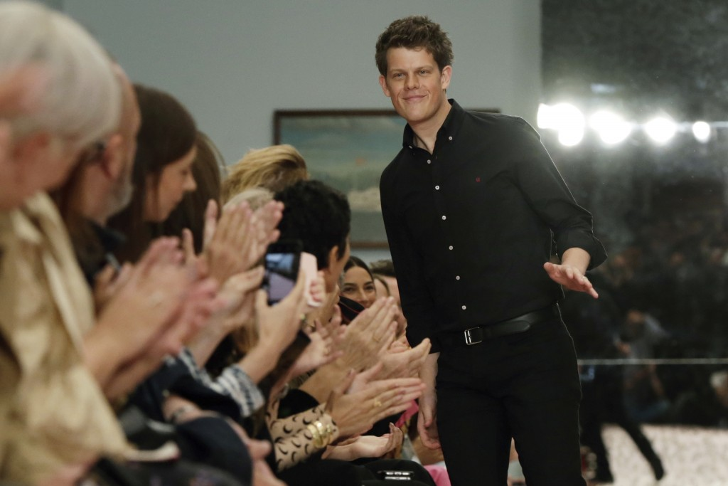 Creative Director Wes Gordon acknowledges audience applause after the Carolina Herrera spring 2019 collection was modeled during Fashion Week in New Y