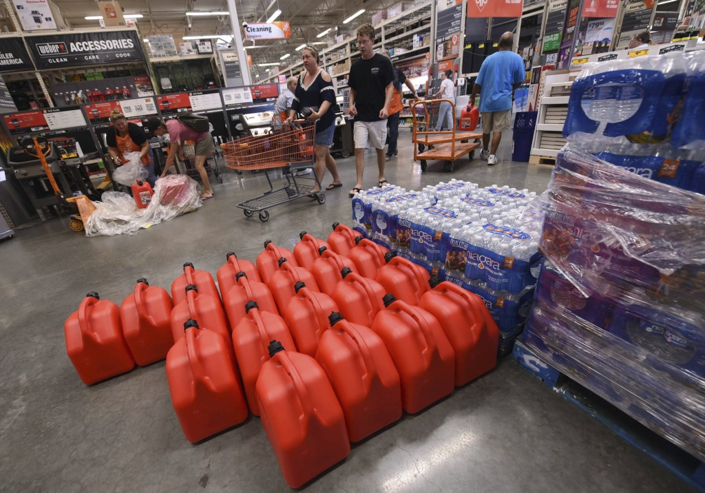 People buy supplies at The Home Depot on Monday, Sept. 10, 2018, in Wilmington, N.C. Florence rapidly strengthened into a potentially catastrophic hur