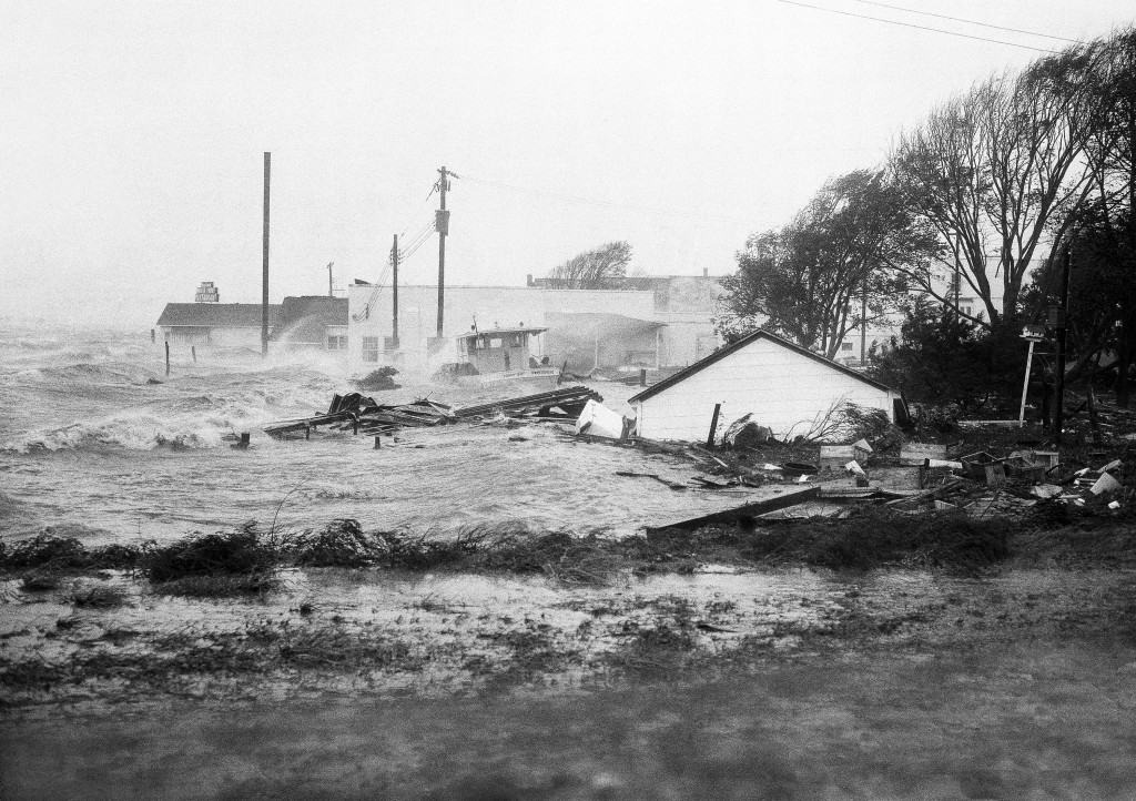 FILE-In this Oct. 15, 1954 file photo, High tides, whipped in by Hurricane Hazel, shatter boats and buildings in Swansboro, N.C., as the storm lashes