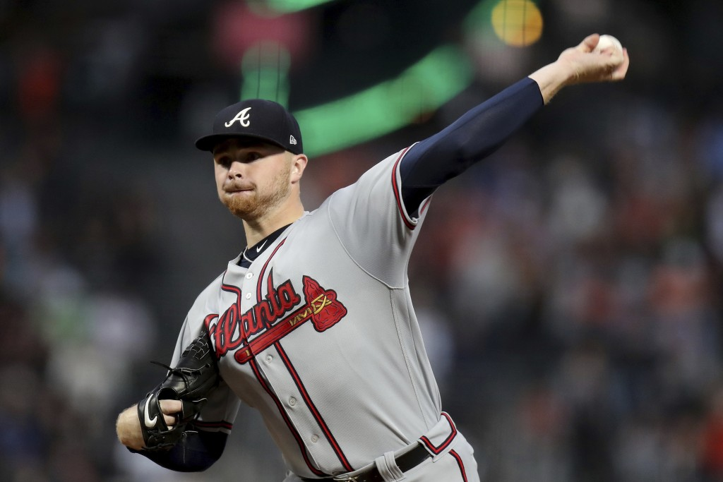 Atlanta Braves starting pitcher Sean Newcomb (15) throws a pitch in the first inning of a baseball game against the San Francisco Giants in San Franci