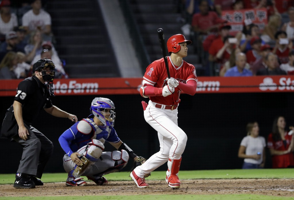 Los Angeles Angels' Shohei Ohtani follows through on a double against the Texas Rangers during the fourth inning of a baseball game Monday, Sept. 10,