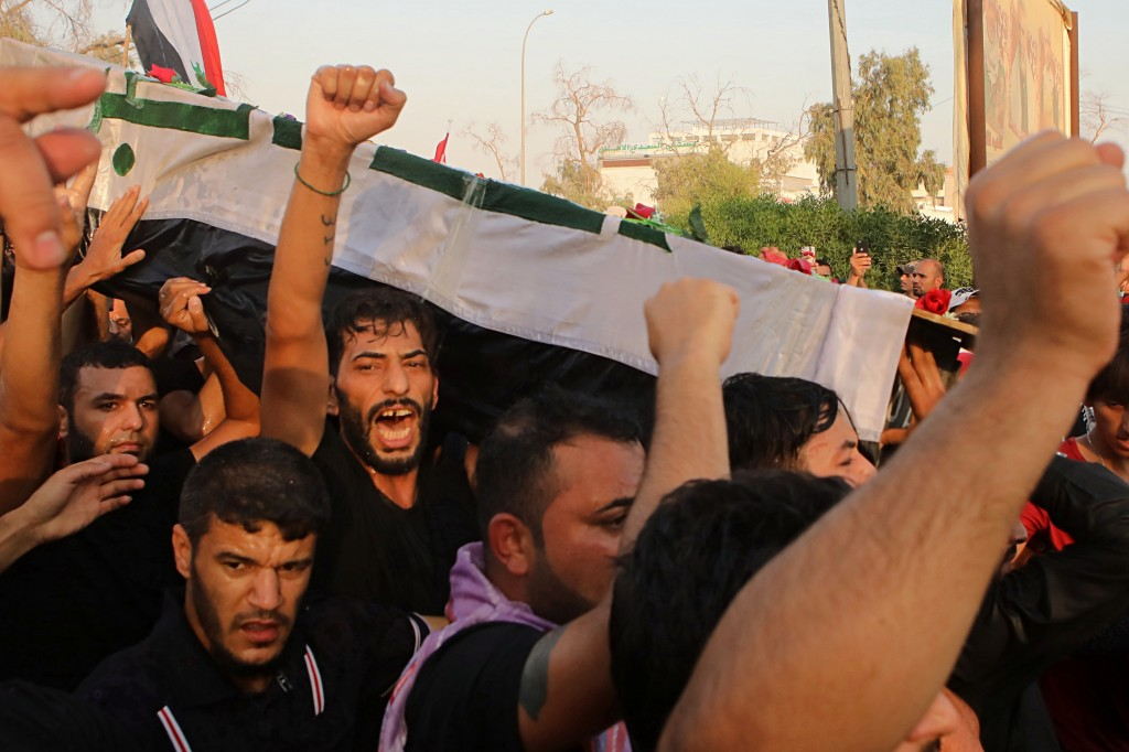 FILE - In this Friday, Sept. 7, 2018 file photo, mourners chant anti government slogans while carrying the coffin of Abdul Salam Fathi, a protester wh