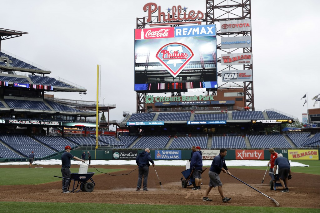 Grounds crew members work on the infield of Citizens Bank Park before a baseball game between the Philadelphia Phillies and Washington Nationals, Mond