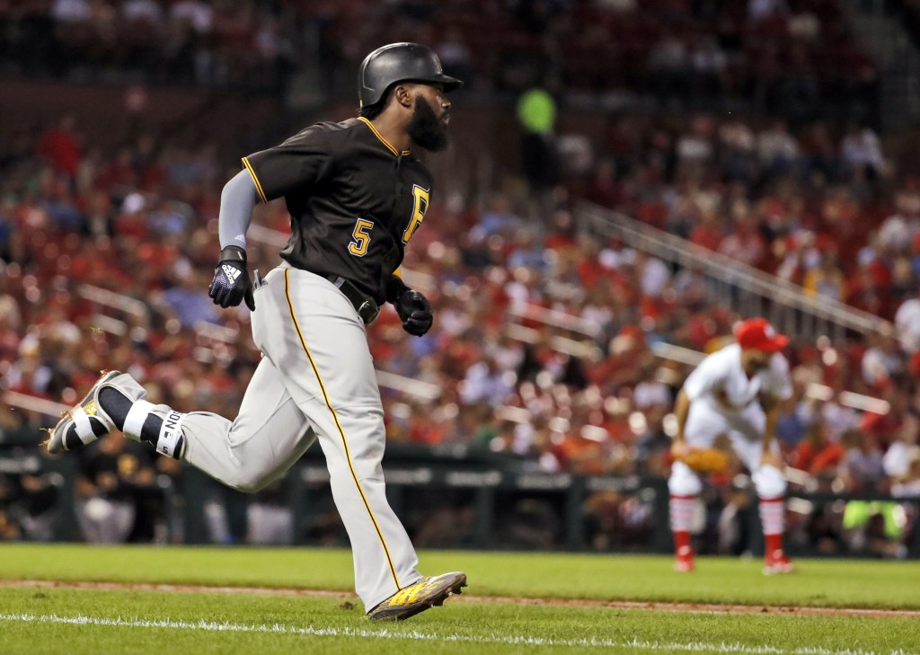 Pittsburgh Pirates' Josh Harrison (5) rounds the bases after hitting a solo home run off St. Louis Cardinals relief pitcher Chasen Shreve during the s