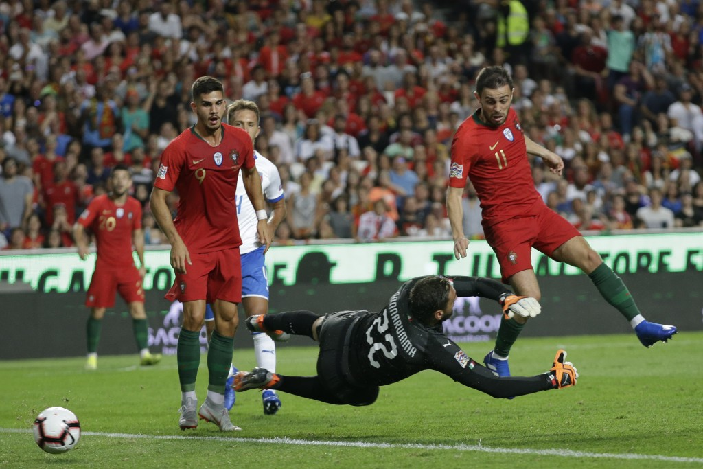 Portugal's Bernardo Silva, right tries to score past Italy goalkeeper Gianluigi Donnarumma during the UEFA Nations League soccer match between Portuga
