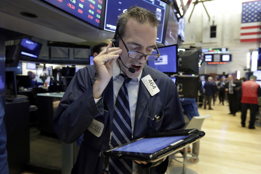 FILE- In this Sept. 6 2018, file photo trader Gregory Rowe works on the floor of the New York Stock Exchange. The U.S. stock market opens at 9:30 a.m....